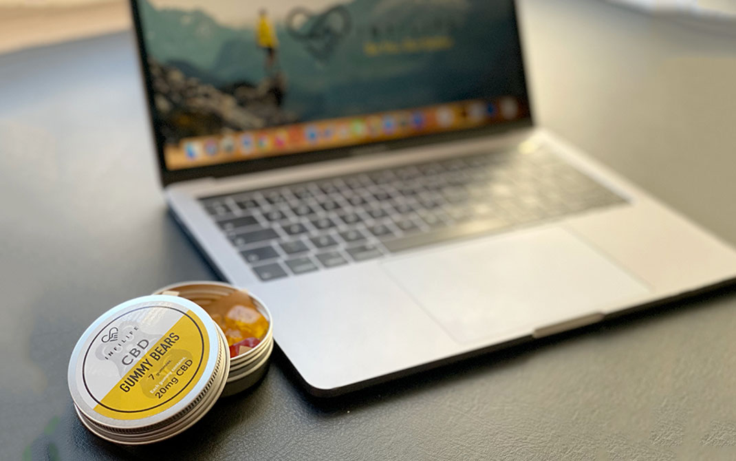 CBD Gummy Infilife CBD with laptop